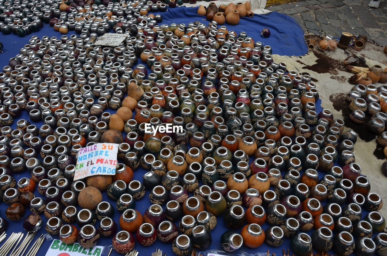 High Angle View Of Yerba Mate Containers For Sale At Market