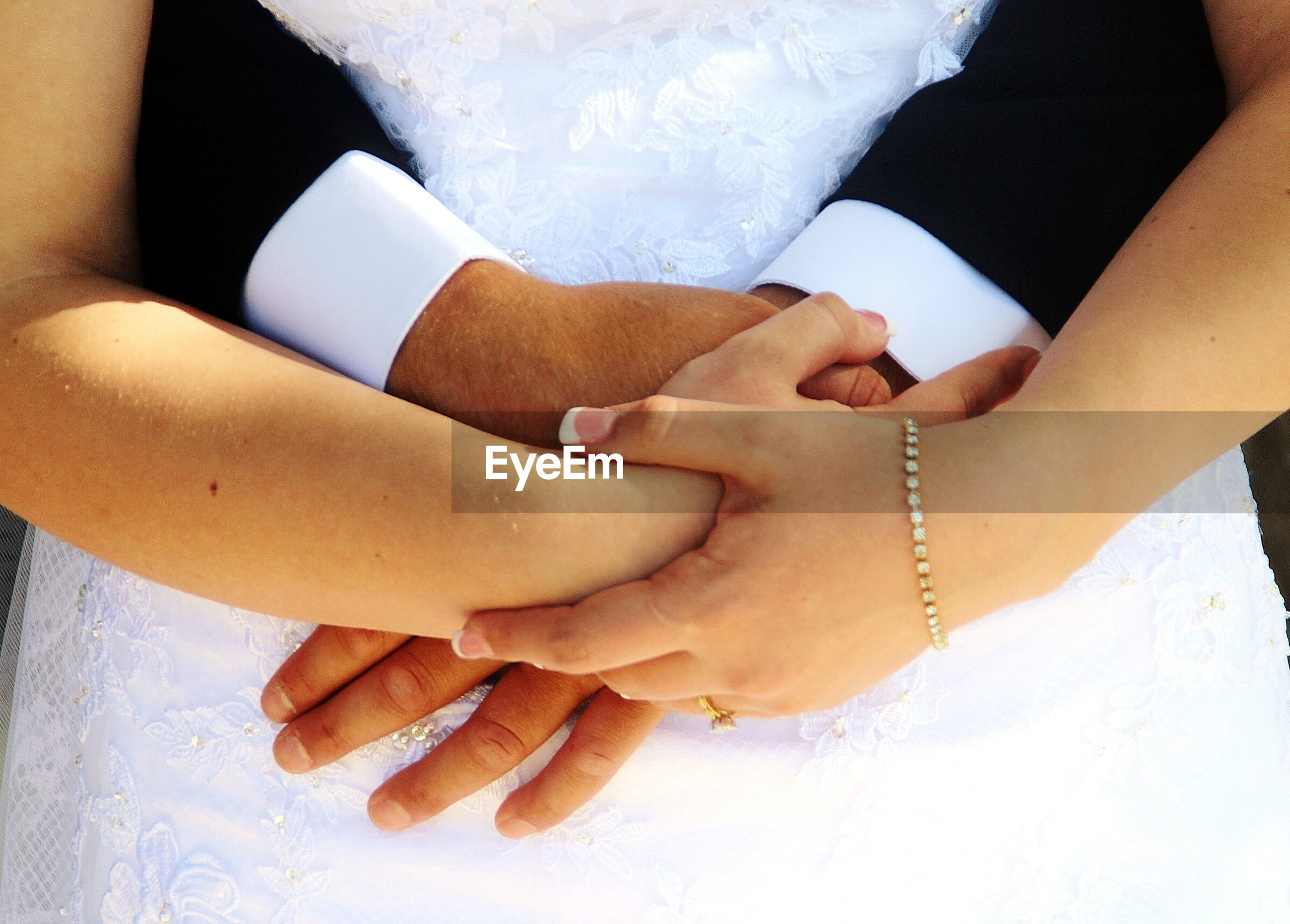 bride, human hand, togetherness, love, wedding, men, women, bridegroom, wedding dress, bonding, real people, two people, celebration, groom, couple - relationship, life events, midsection, holding, human body part, wedding ceremony, wife, close-up, day, outdoors, adult, people