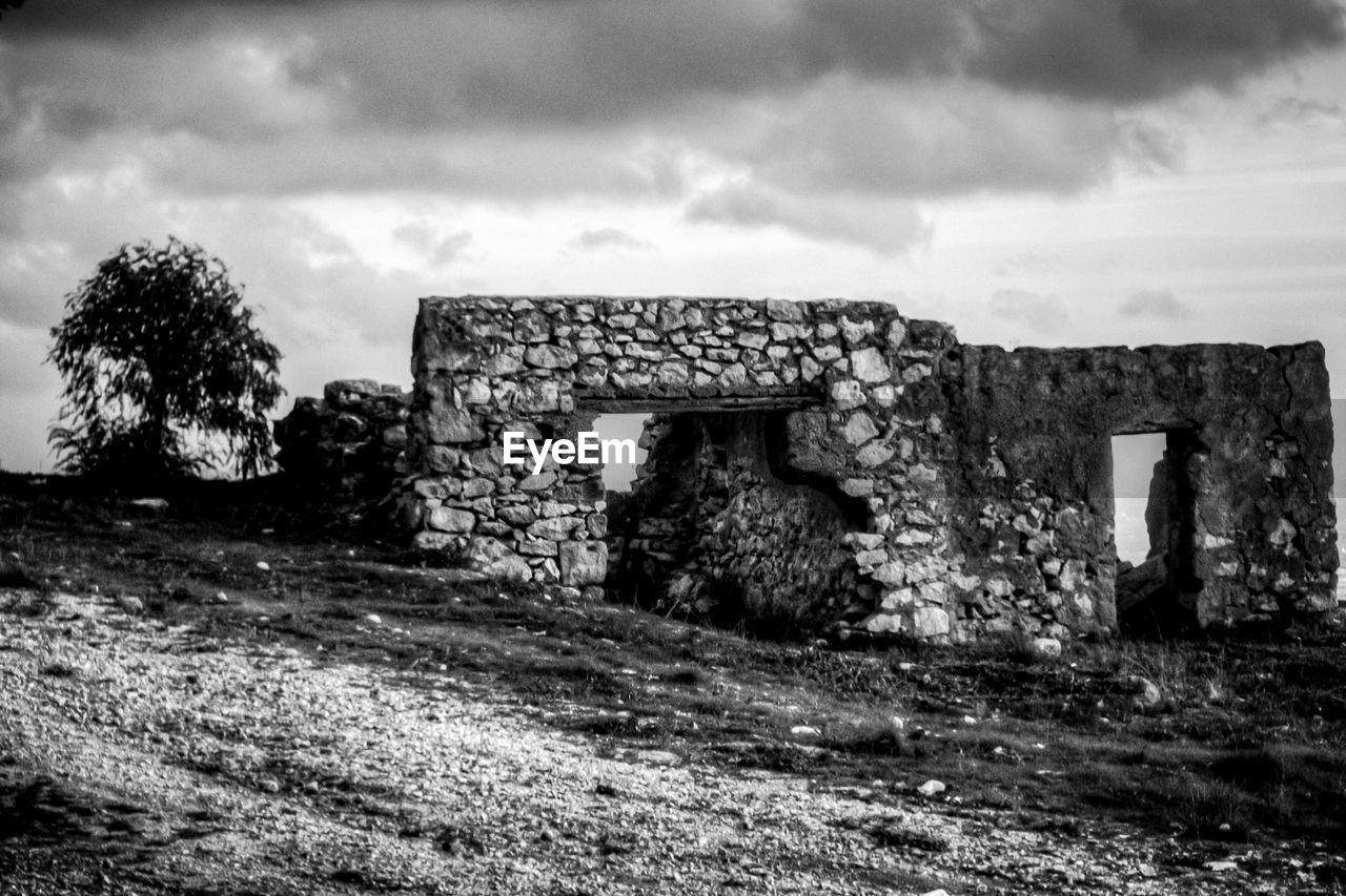 old ruin, built structure, history, old, architecture, the past, damaged, sky, day, abandoned, no people, building exterior, ancient, outdoors, cloud - sky, nature, grass, ancient civilization