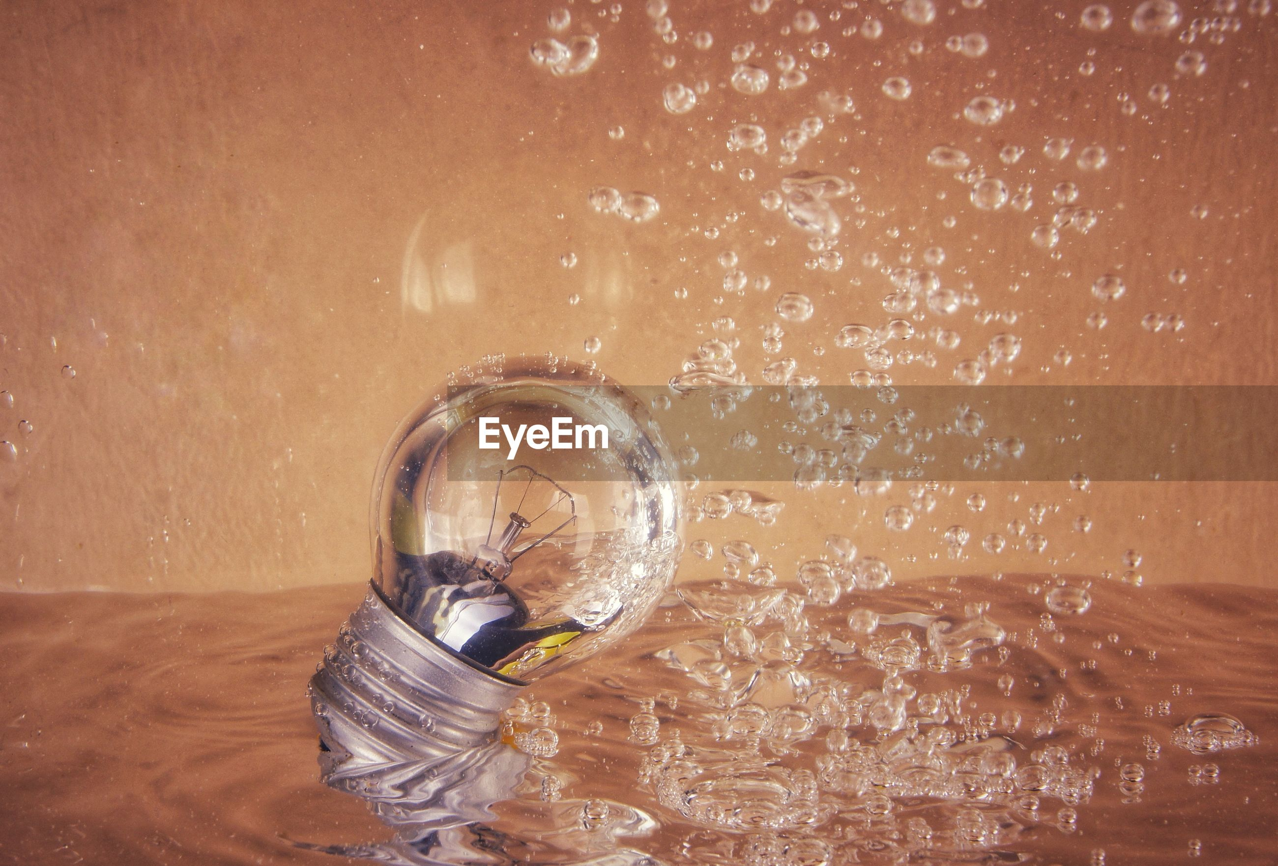Bulb in water with bubbles