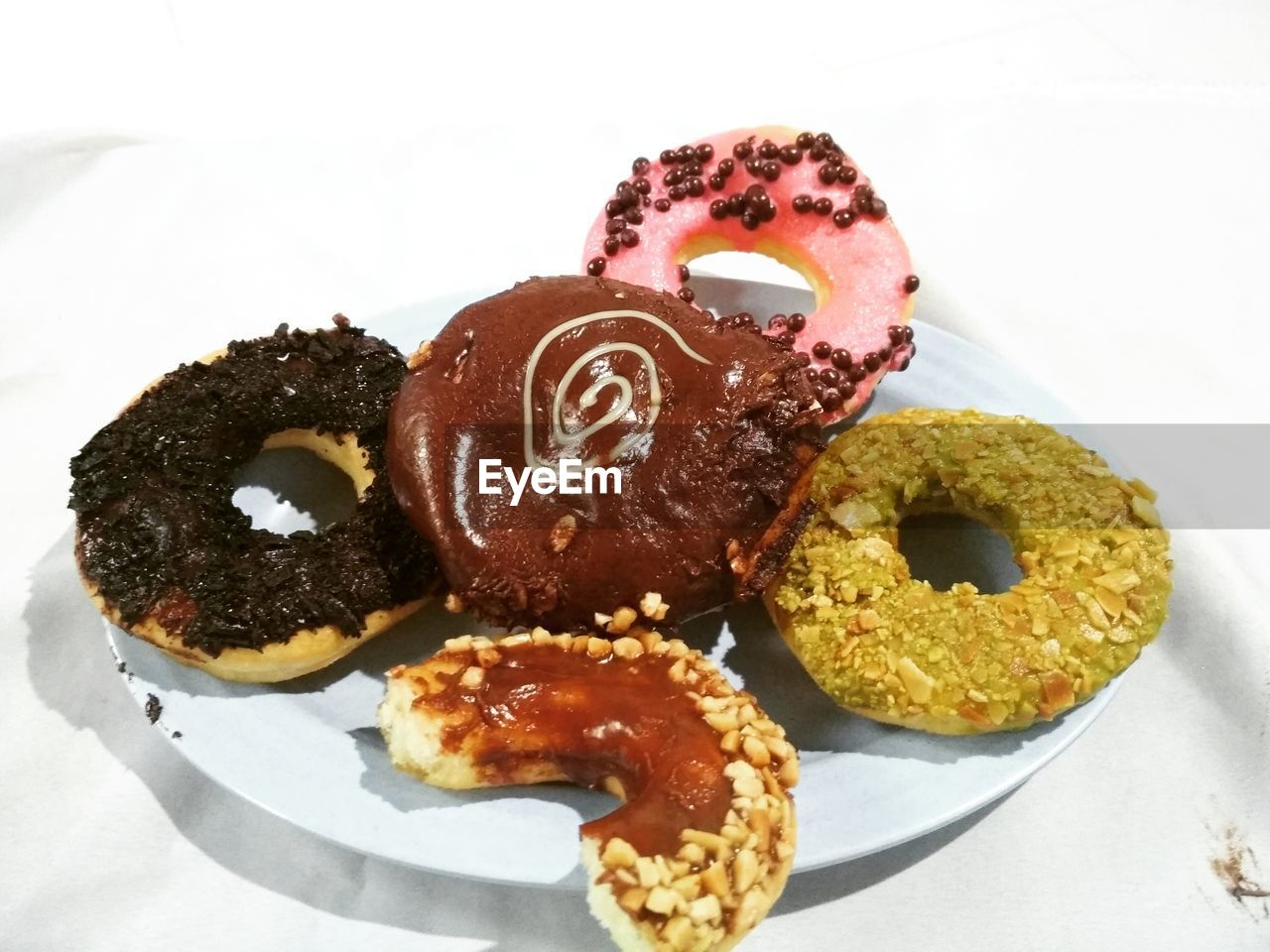 food and drink, food, sweet food, indulgence, dessert, sweet, still life, baked, indoors, ready-to-eat, temptation, freshness, unhealthy eating, close-up, plate, donut, no people, table, high angle view, white background, snack, glazed food