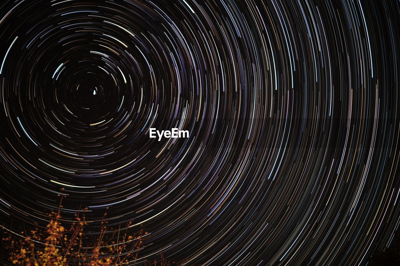 night, astronomy, space, star trail, star - space, motion, long exposure, no people, nature, sky, scenics - nature, beauty in nature, circle, low angle view, spinning, geometric shape, star, concentric, infinity, tranquility, directly below