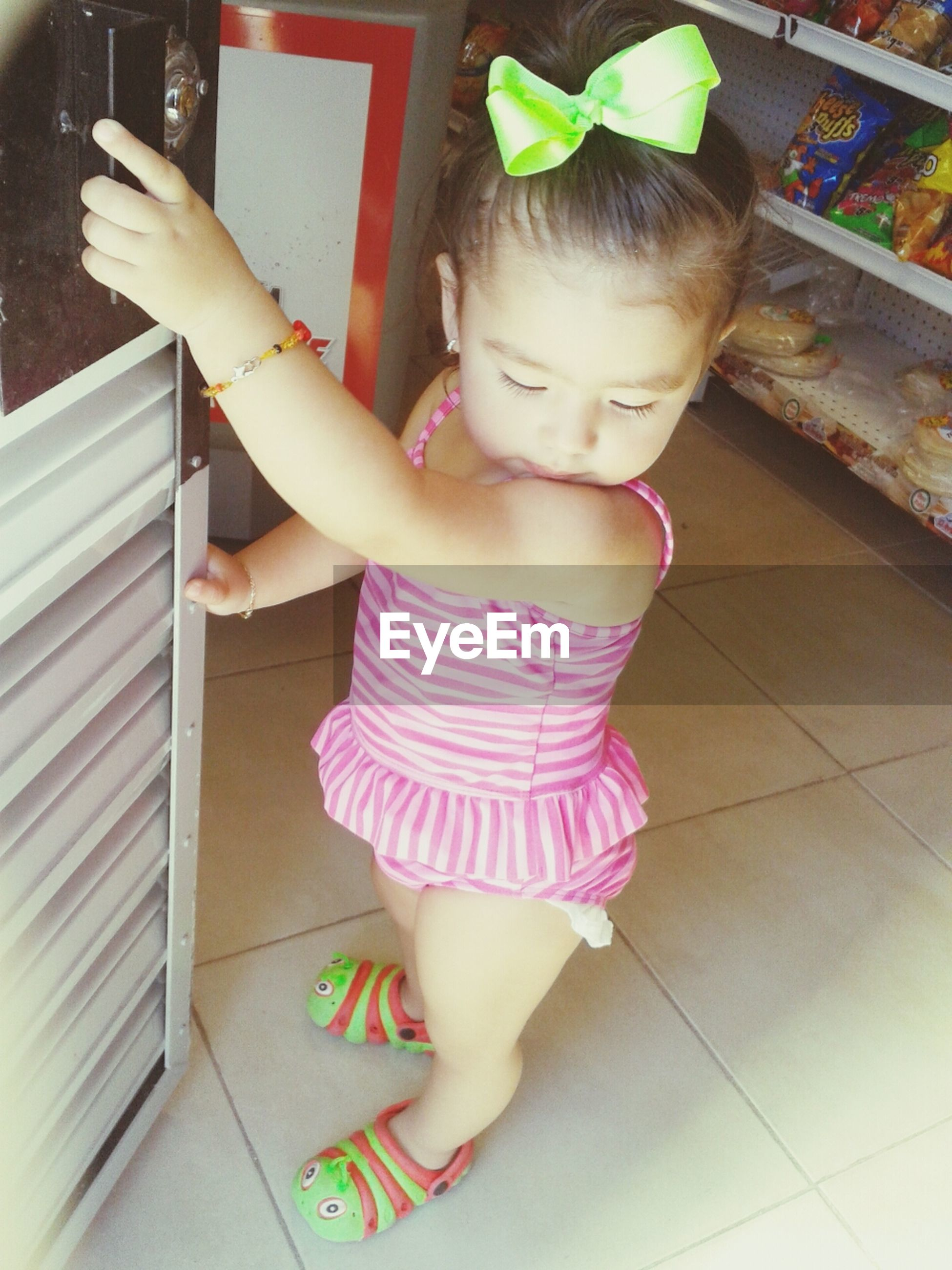 childhood, elementary age, cute, innocence, person, girls, indoors, lifestyles, boys, casual clothing, full length, leisure activity, high angle view, playing, toddler, holding, preschool age, playful