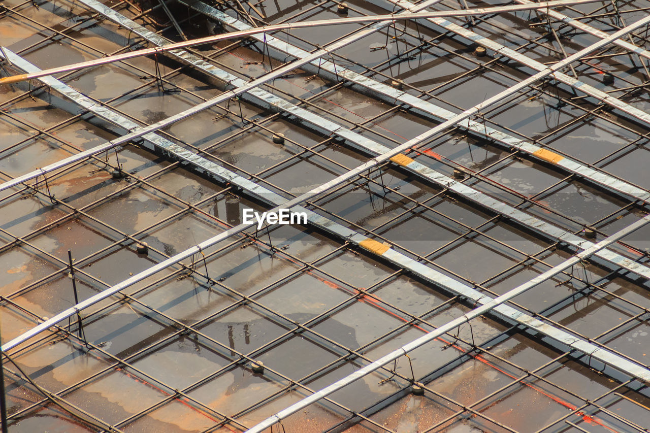 built structure, architecture, low angle view, full frame, backgrounds, no people, pattern, building exterior, metal, building, day, outdoors, modern, repetition, railing, industry, city, rod, scaffolding, glass - material, ceiling, apartment