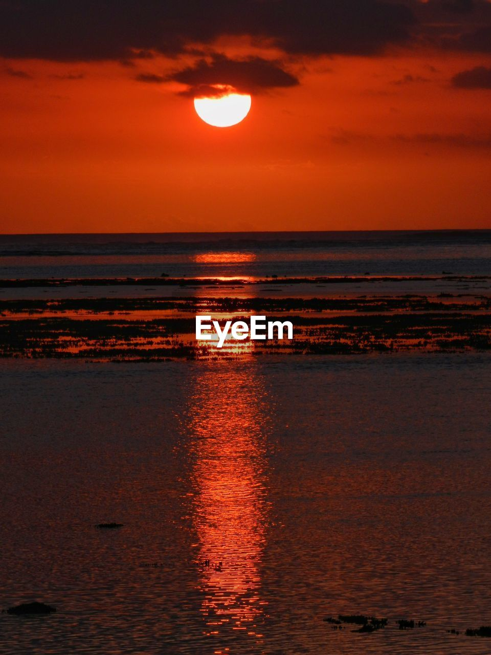 sunset, sea, beauty in nature, nature, scenics, water, sky, sun, orange color, tranquil scene, tranquility, horizon over water, reflection, outdoors, idyllic, waterfront, no people, beach, silhouette, cloud - sky, day