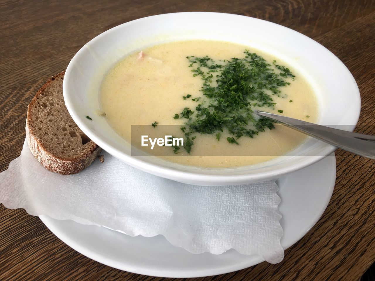 food and drink, food, freshness, table, indoors, eating utensil, soup, healthy eating, spoon, no people, high angle view, wellbeing, kitchen utensil, ready-to-eat, still life, directly above, bowl, bread, plate, meal, soup bowl, garnish, crockery