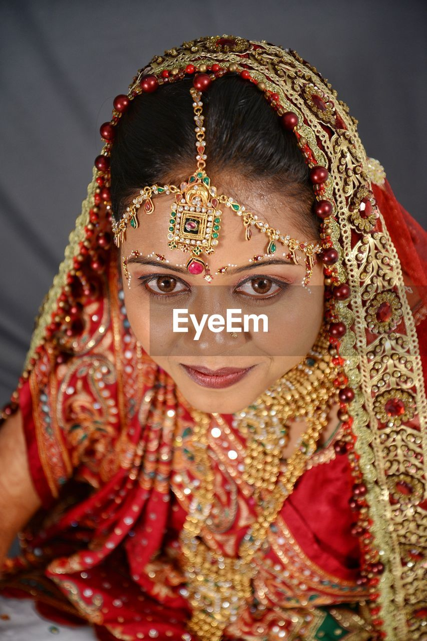 one person, traditional clothing, portrait, headshot, front view, celebration, real people, young adult, indoors, young women, women, lifestyles, clothing, looking at camera, jewelry, adult, beautiful woman, wedding ceremony, festival