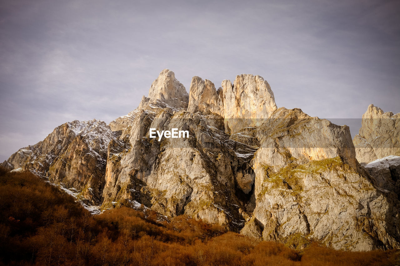 PANORAMIC VIEW OF ROCK FORMATION AGAINST SKY