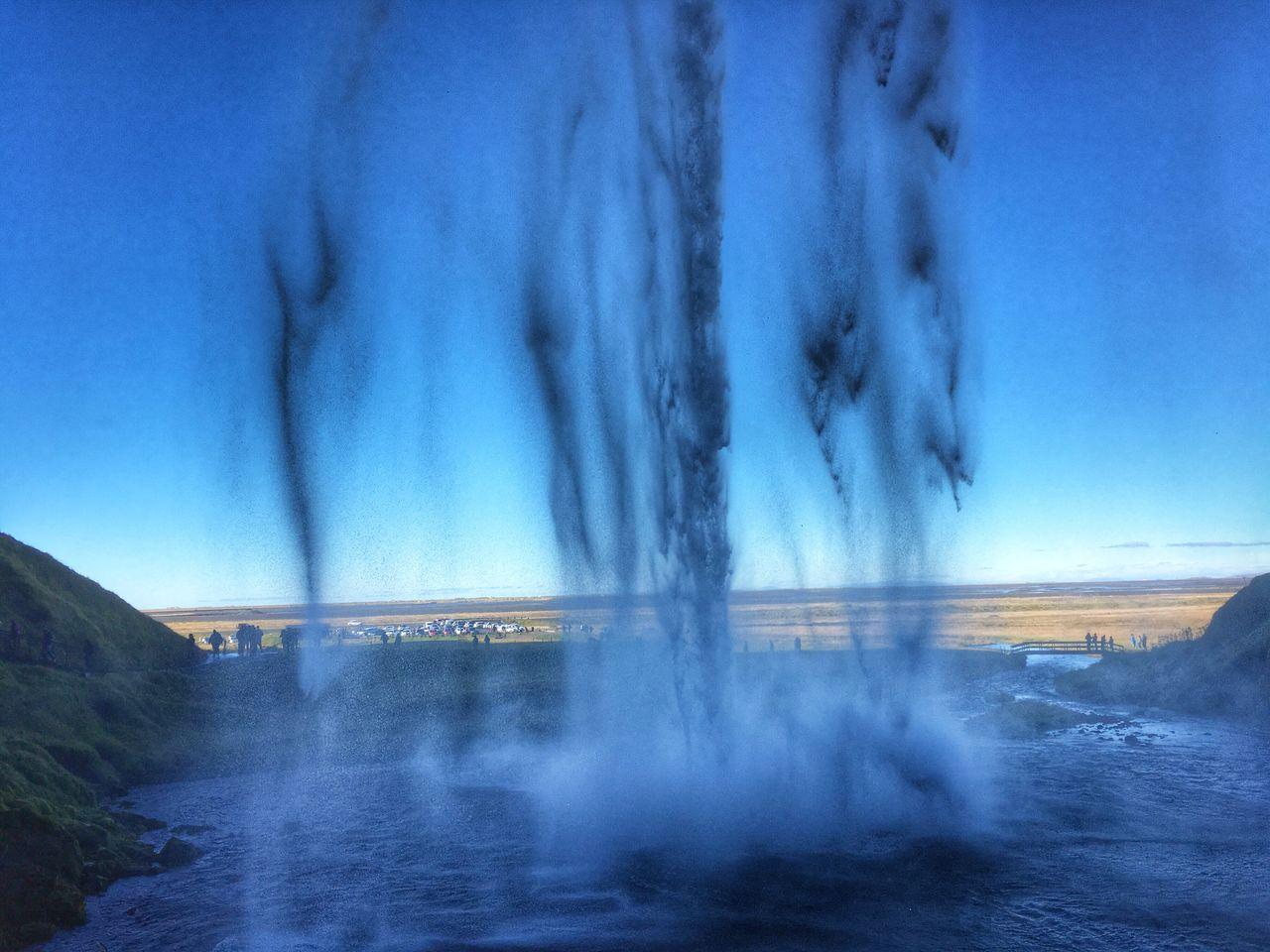 Blurred Motion Of Water Splashing Against Blue Sky