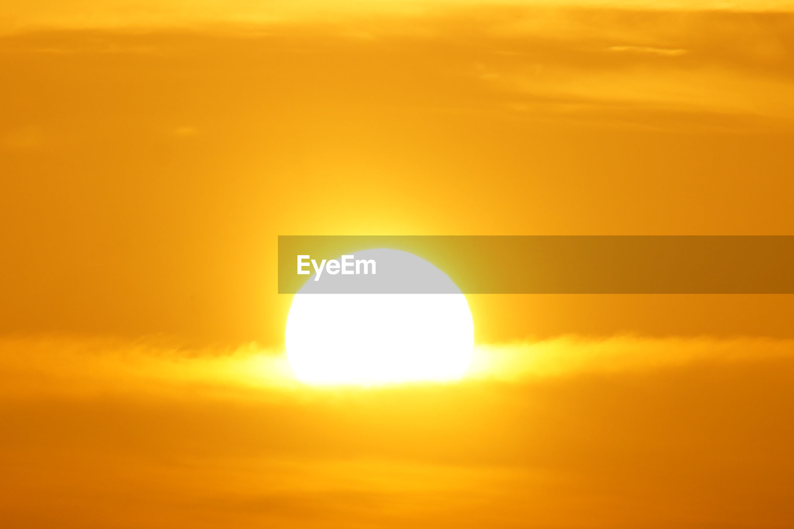 sun, yellow, sunset, orange color, beauty in nature, circle, sky, scenics, cloud - sky, nature, sunlight, bright, solar eclipse, outdoors, technology, no people, summer, alternative energy, close-up, day