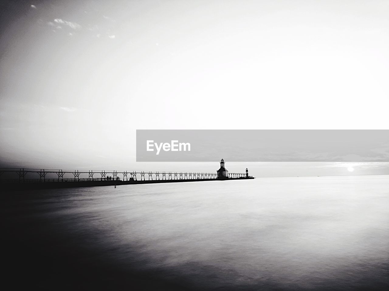 Pier on lake against clear sky
