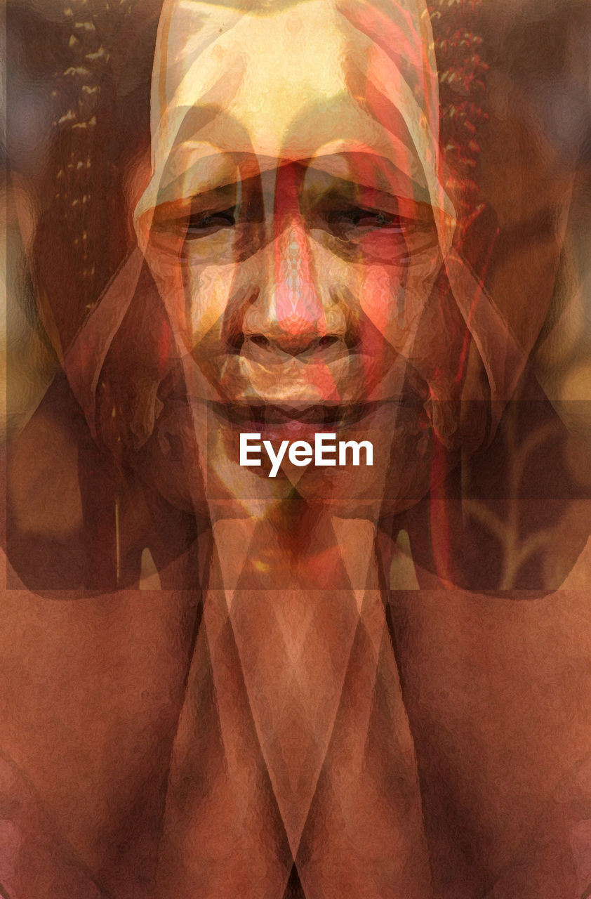 DIGITAL COMPOSITE IMAGE OF MAN WEARING MULTI COLORED FACE