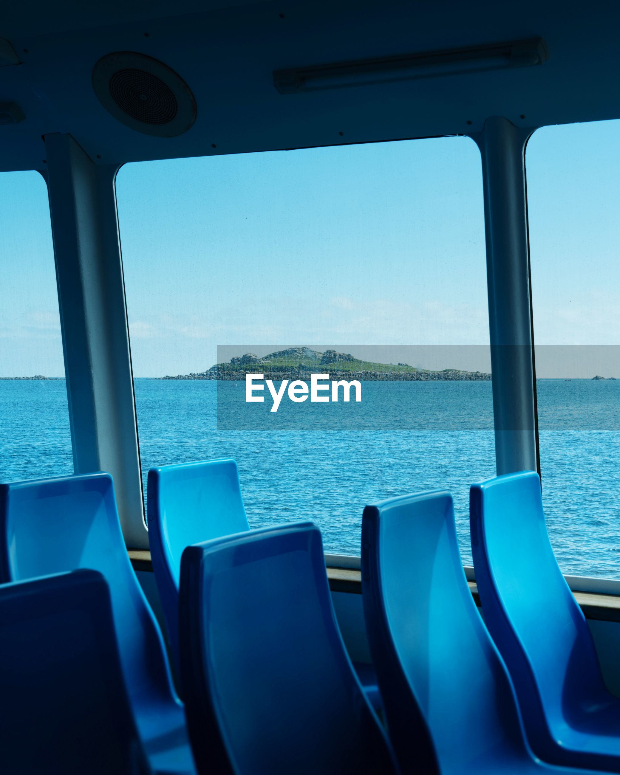 water, sea, sky, no people, vehicle interior, nautical vessel, nature, window, scenics - nature, mode of transportation, transportation, day, transparent, blue, seat, beauty in nature, glass - material, tranquility, tranquil scene, outdoors, horizon over water, passenger craft