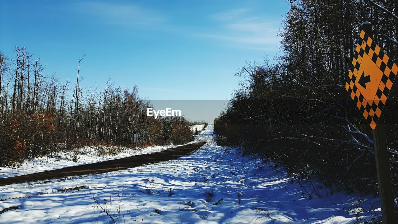 snow, cold temperature, winter, nature, bare tree, weather, tree, beauty in nature, transportation, outdoors, day, rail transportation, no people, sky, the way forward, scenics