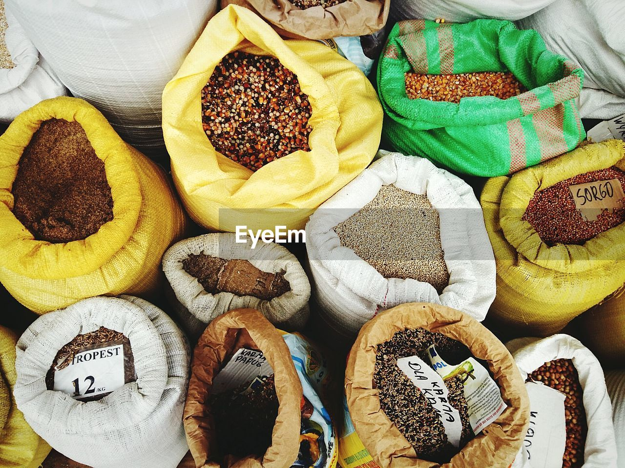 High Angle View Of Grains In Sacks For Sale At Market Stall