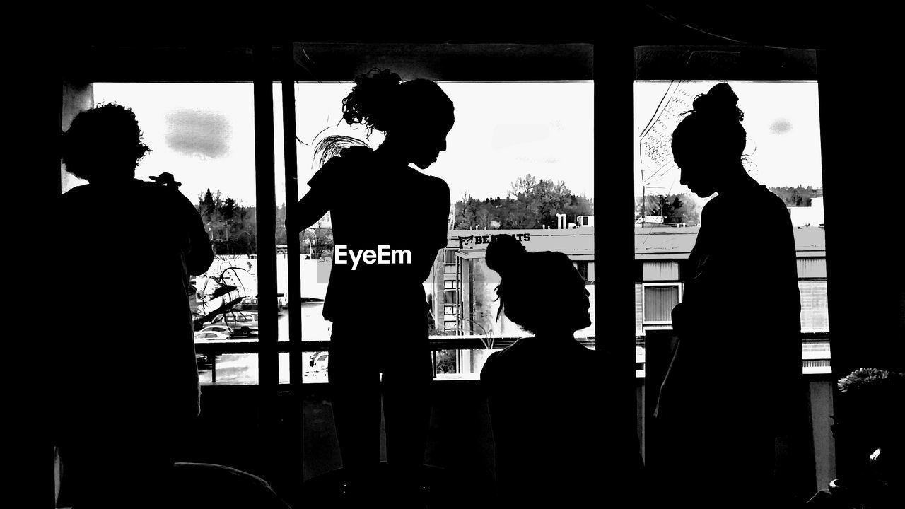 Silhouette Women By Glass Window At Home