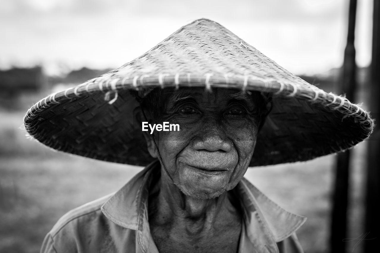 Close-Up Portrait Of Senior Man Wearing Hat