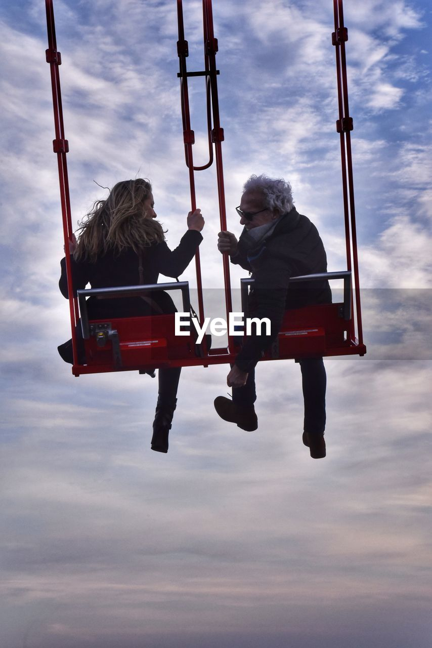 two people, sky, cloud - sky, men, full length, real people, males, people, adult, nature, togetherness, holding, lifestyles, leisure activity, sitting, women, bonding, positive emotion, day, love, outdoors, couple - relationship, mature men, care
