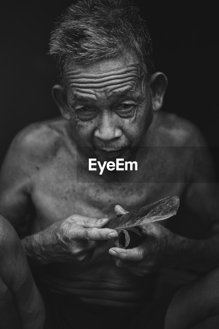 Portrait Of Senior Man Holding Weapon