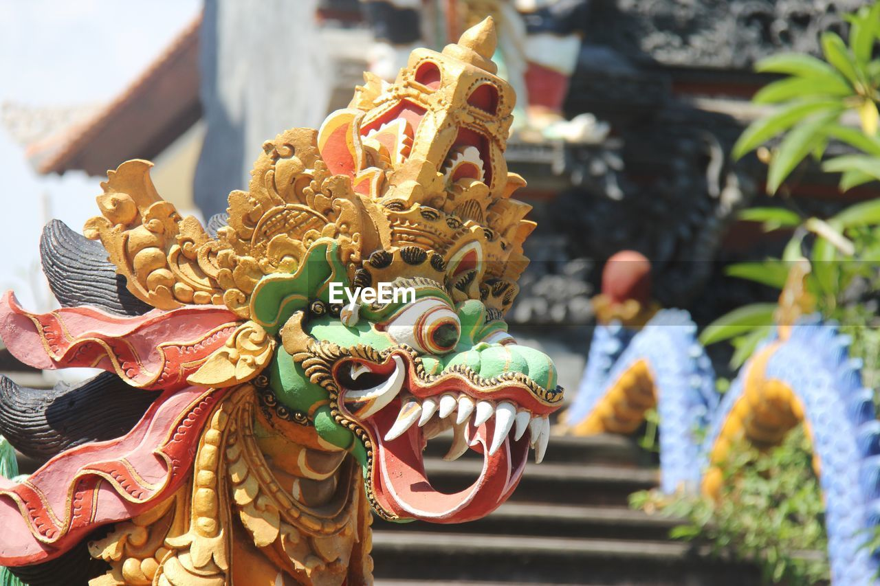 representation, animal representation, art and craft, sculpture, creativity, belief, statue, focus on foreground, dragon, religion, spirituality, no people, craft, architecture, close-up, day, place of worship, outdoors, chinese dragon, festival, ornate