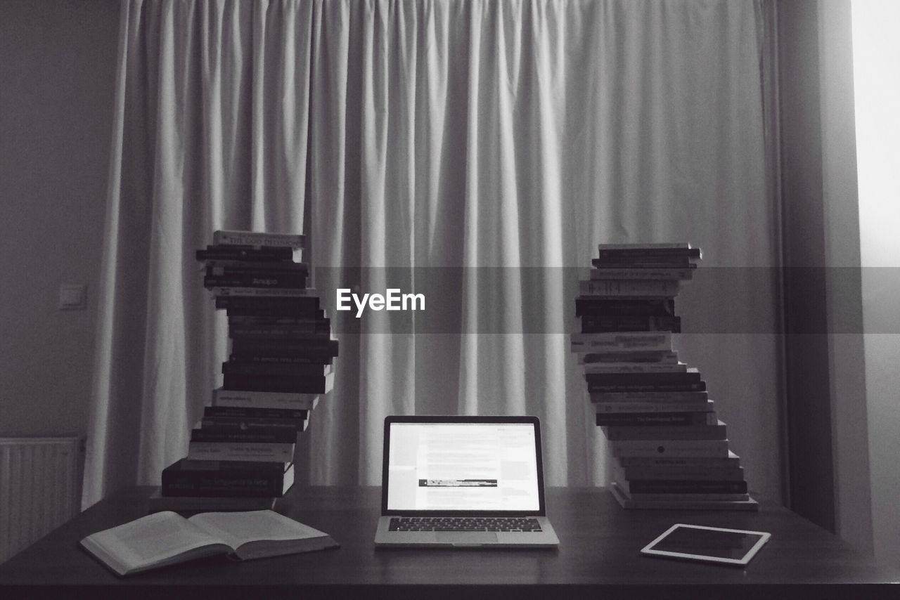indoors, curtain, communication, no people, laptop, book, technology, wireless technology, day