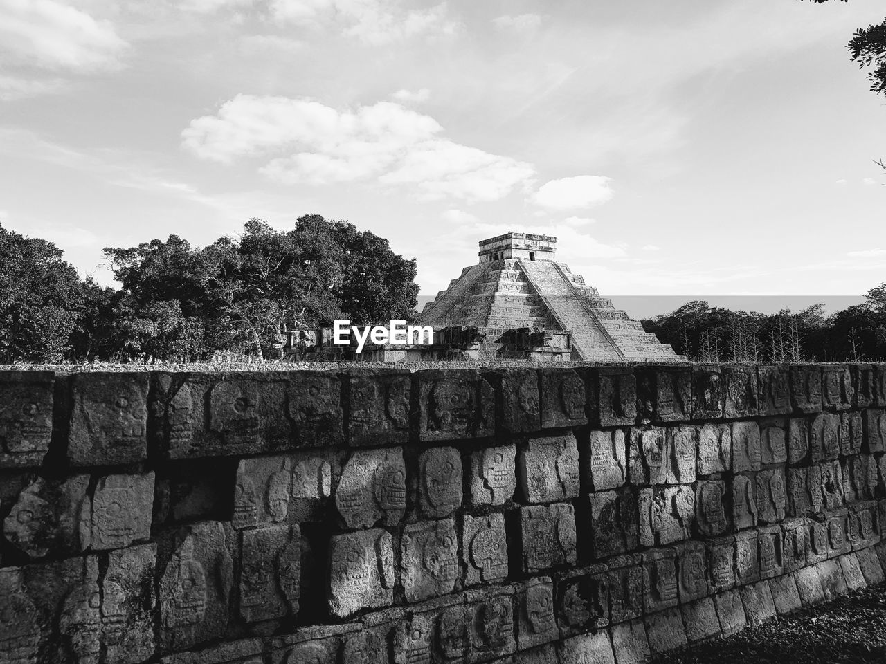 architecture, sky, built structure, cloud - sky, history, the past, wall, building exterior, day, nature, plant, ancient, tree, wall - building feature, travel, no people, tourism, outdoors, stone wall, low angle view, ancient civilization, archaeology