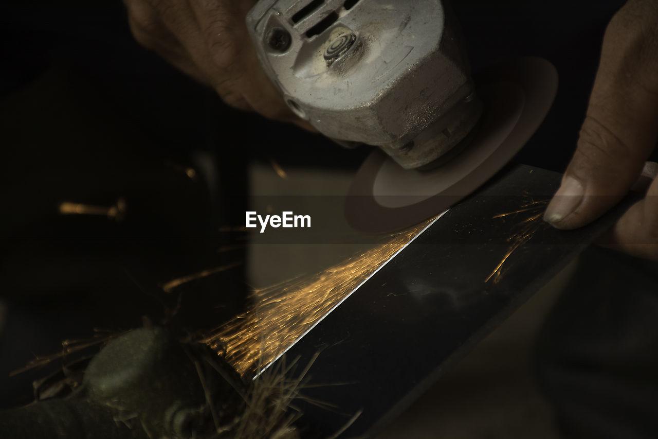 Cropped Image Of Worker Grinding Steel At Workshop