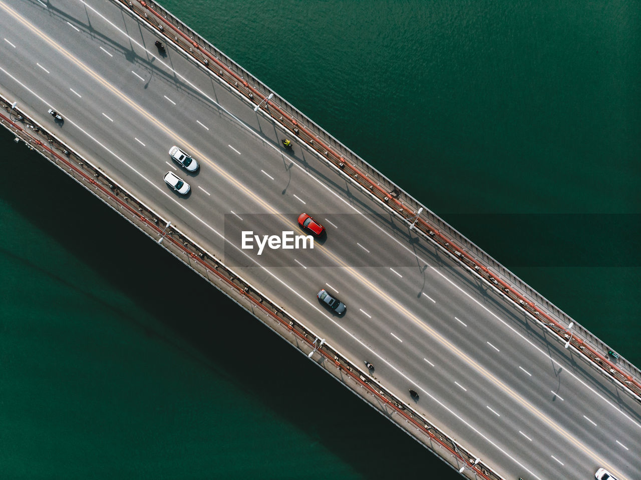 Aerial view of cars moving on bridge over sea