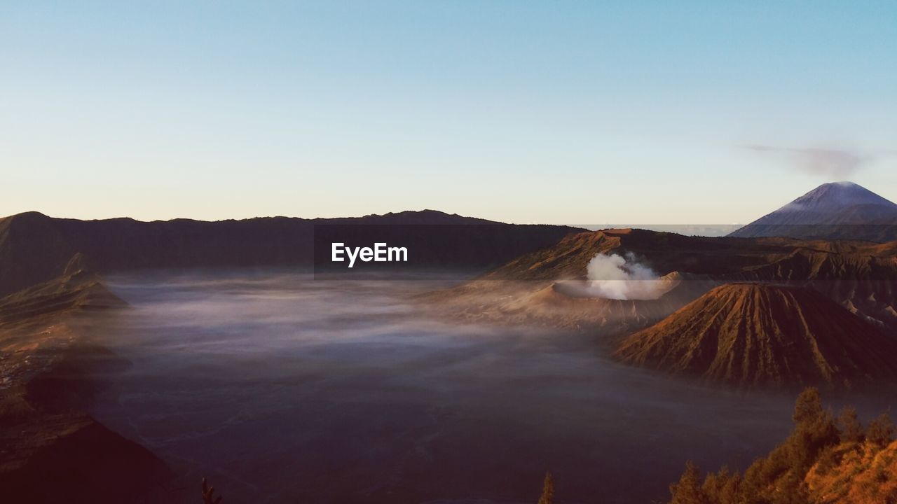 Scenic View Of Mt Bromo Against Clear Sky During Sunrise
