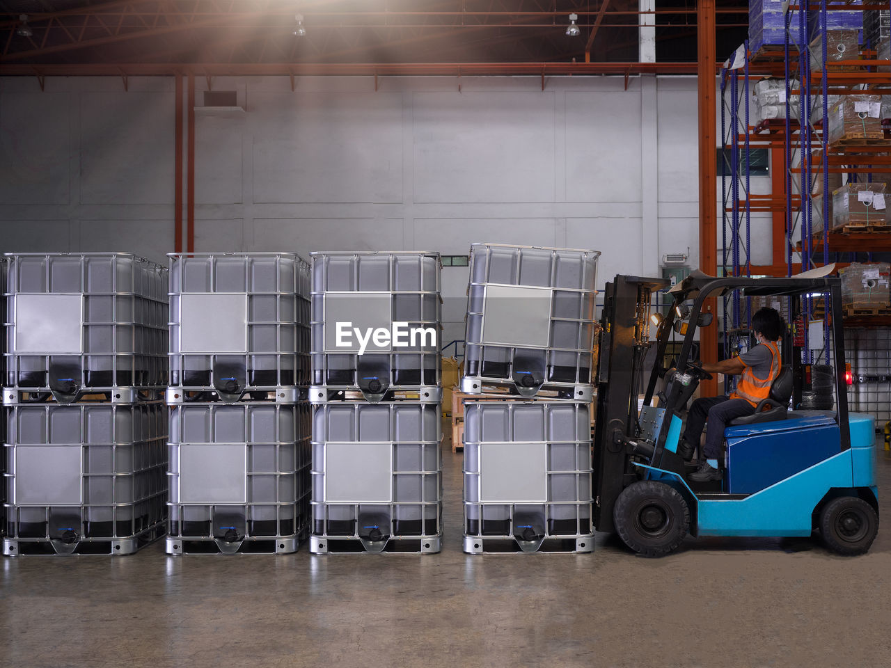 Close-up of forklift by containers