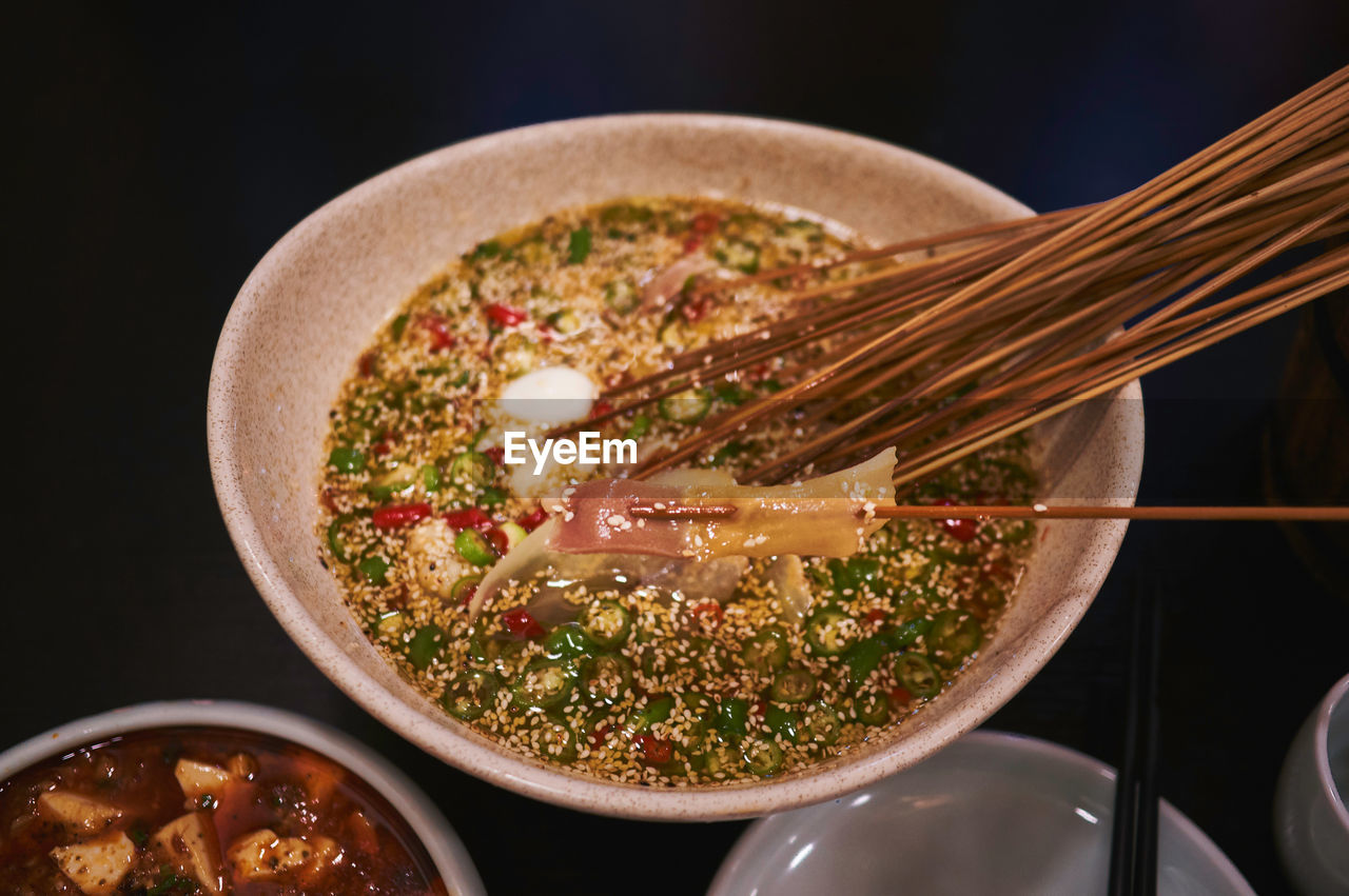 food and drink, food, freshness, indoors, kitchen utensil, ready-to-eat, healthy eating, bowl, close-up, still life, no people, wellbeing, spoon, eating utensil, vegetable, chopsticks, serving size, table, meal, chinese food, crockery