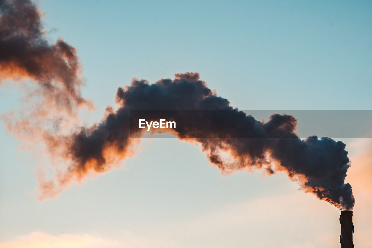 Low Angle View Of Smoke Emitting From Chimney Against Sky