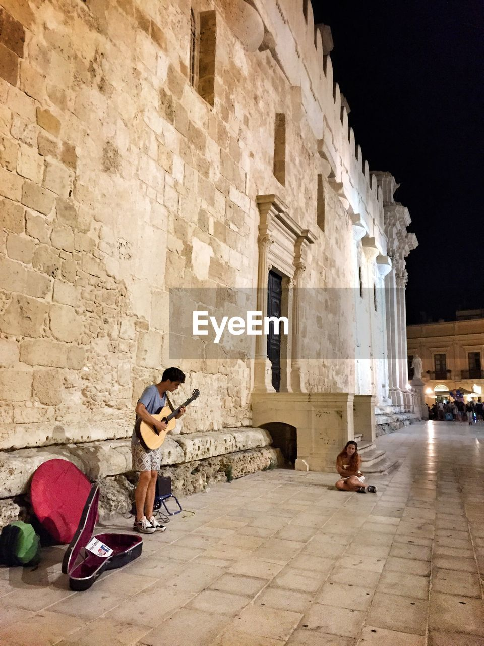 full length, travel, architecture, tourism, vacations, musician, young adult, travel destinations, men, outdoors, music, adult, people, one person, adults only, guitar, building exterior, young women, one man only, day