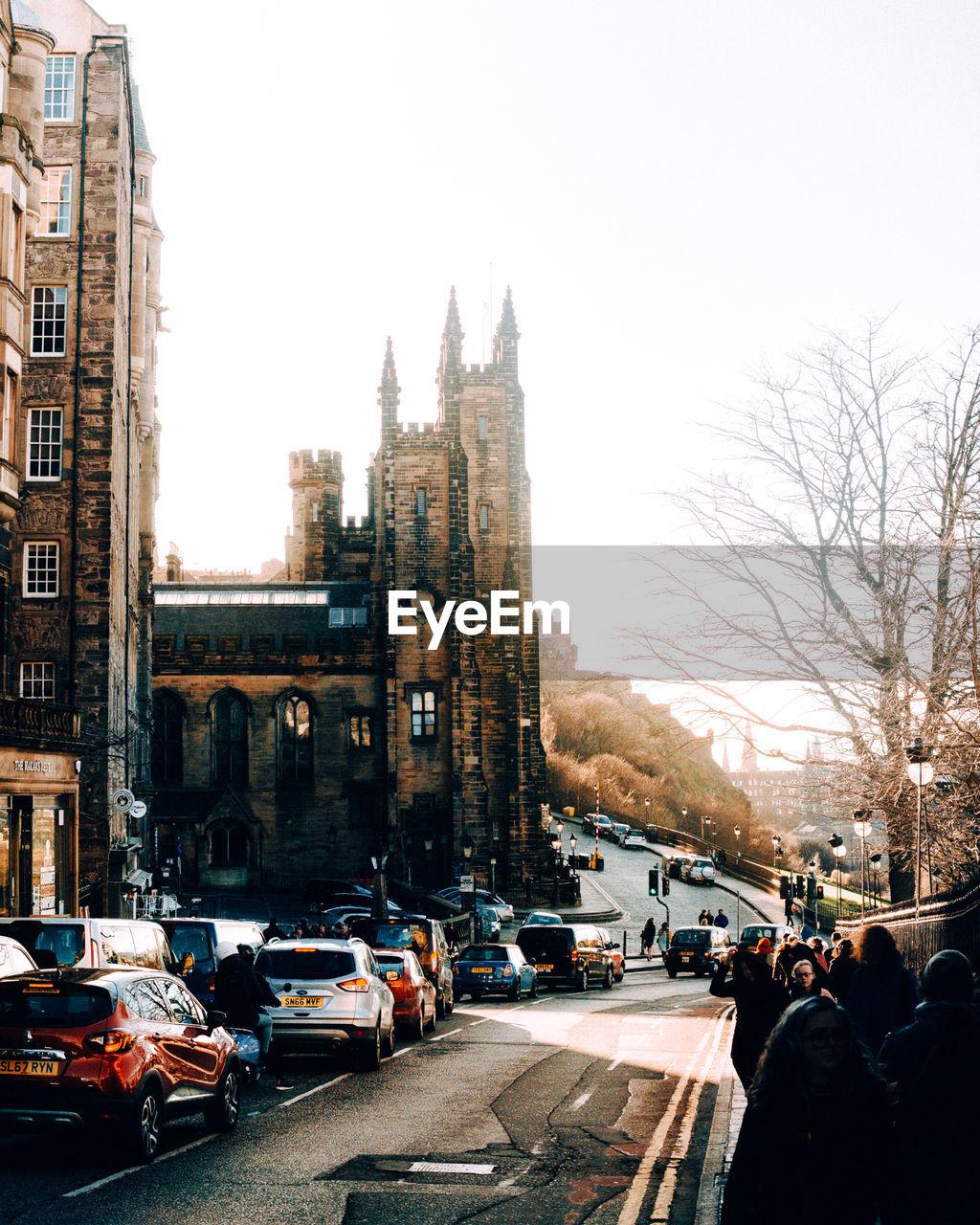 VEHICLES ON CITY STREET AGAINST CLEAR SKY
