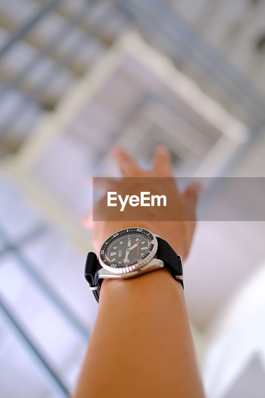 one person, human hand, human body part, real people, wristwatch, close-up, time, indoors, watch, focus on foreground, day, clock, minute hand, people