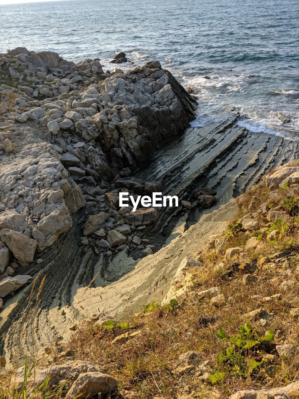 rock, sea, water, rock - object, solid, land, beach, no people, beauty in nature, nature, scenics - nature, day, rock formation, tranquility, tranquil scene, high angle view, non-urban scene, geology, outdoors, rocky coastline, eroded