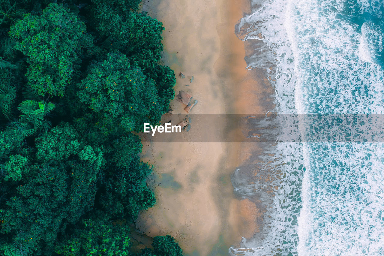 water, sea, motion, beauty in nature, no people, nature, high angle view, scenics - nature, land, beach, aquatic sport, day, wave, outdoors, sport, power in nature, aerial view, green color, turquoise colored