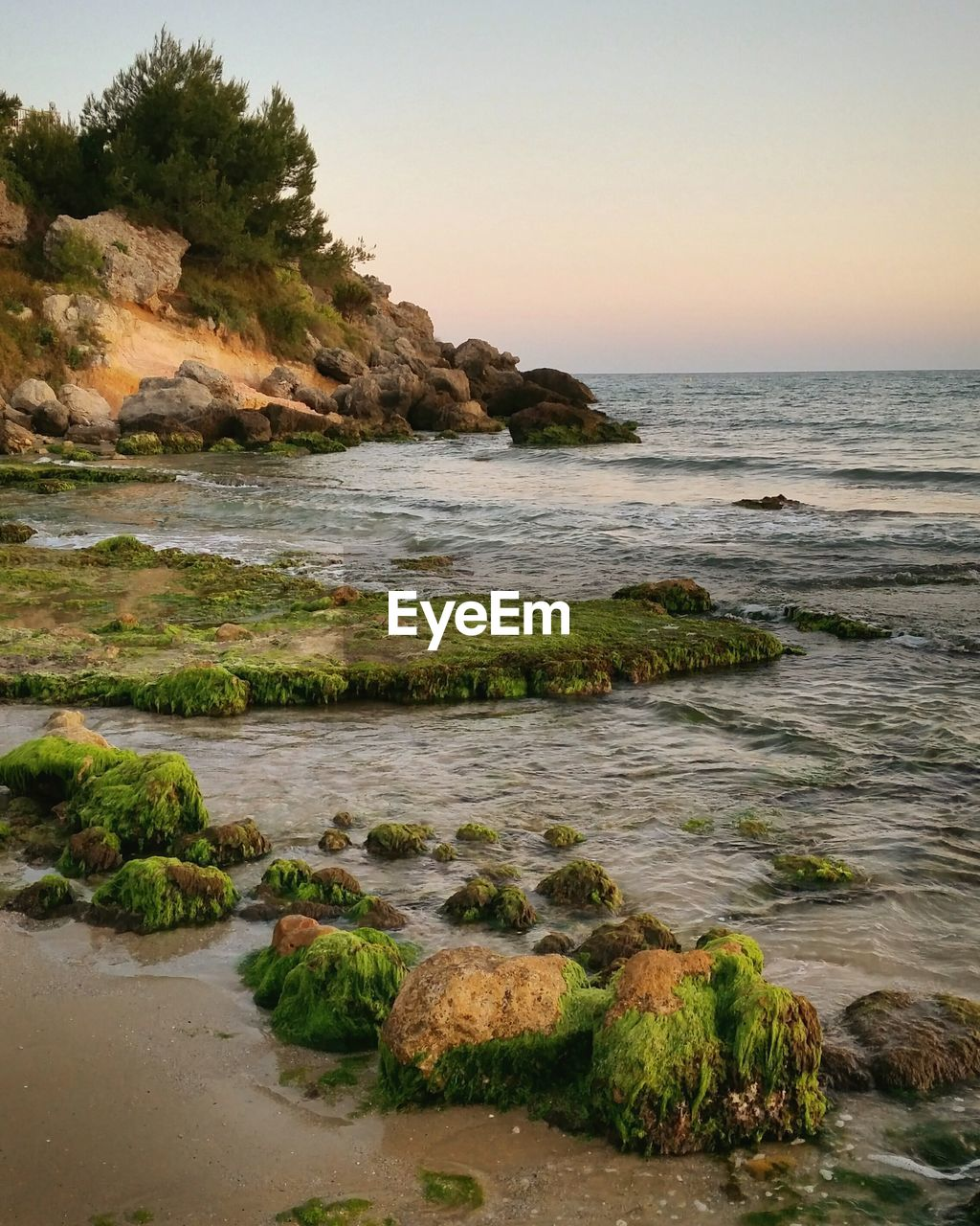 sea, rock - object, nature, beauty in nature, water, scenics, no people, horizon over water, rock, tranquility, tranquil scene, beach, outdoors, sky, sunset, clear sky, day, scenery