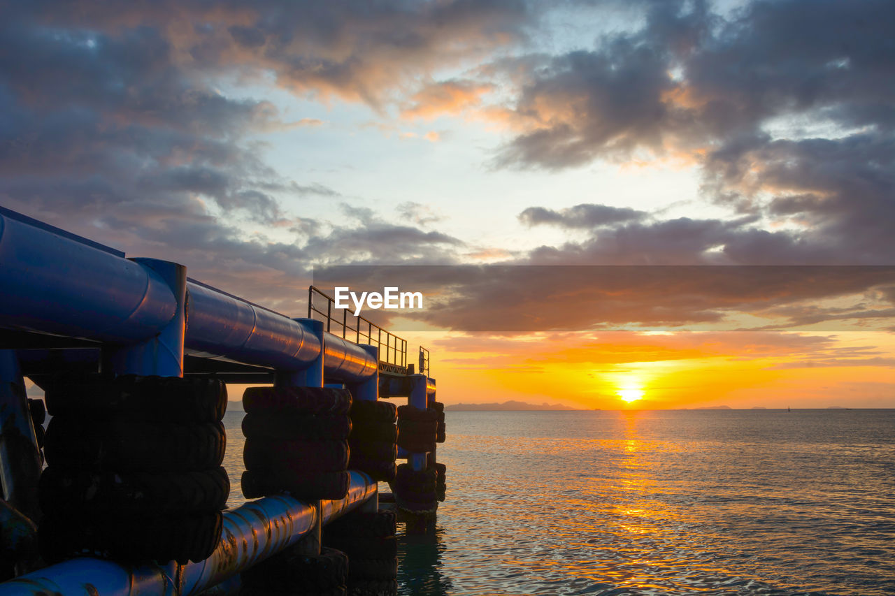 sky, water, cloud - sky, sea, sunset, beauty in nature, orange color, nature, scenics - nature, transportation, horizon over water, horizon, mode of transportation, waterfront, no people, outdoors, built structure, tranquil scene, tranquility