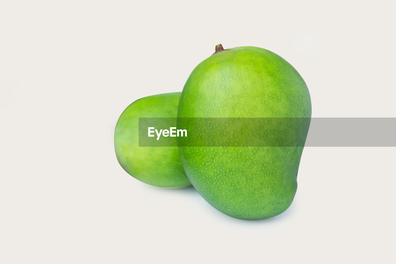 green color, fruit, studio shot, healthy eating, food, white background, food and drink, wellbeing, cut out, still life, freshness, indoors, close-up, no people, granny smith apple, copy space, apple - fruit, apple, single object, two objects
