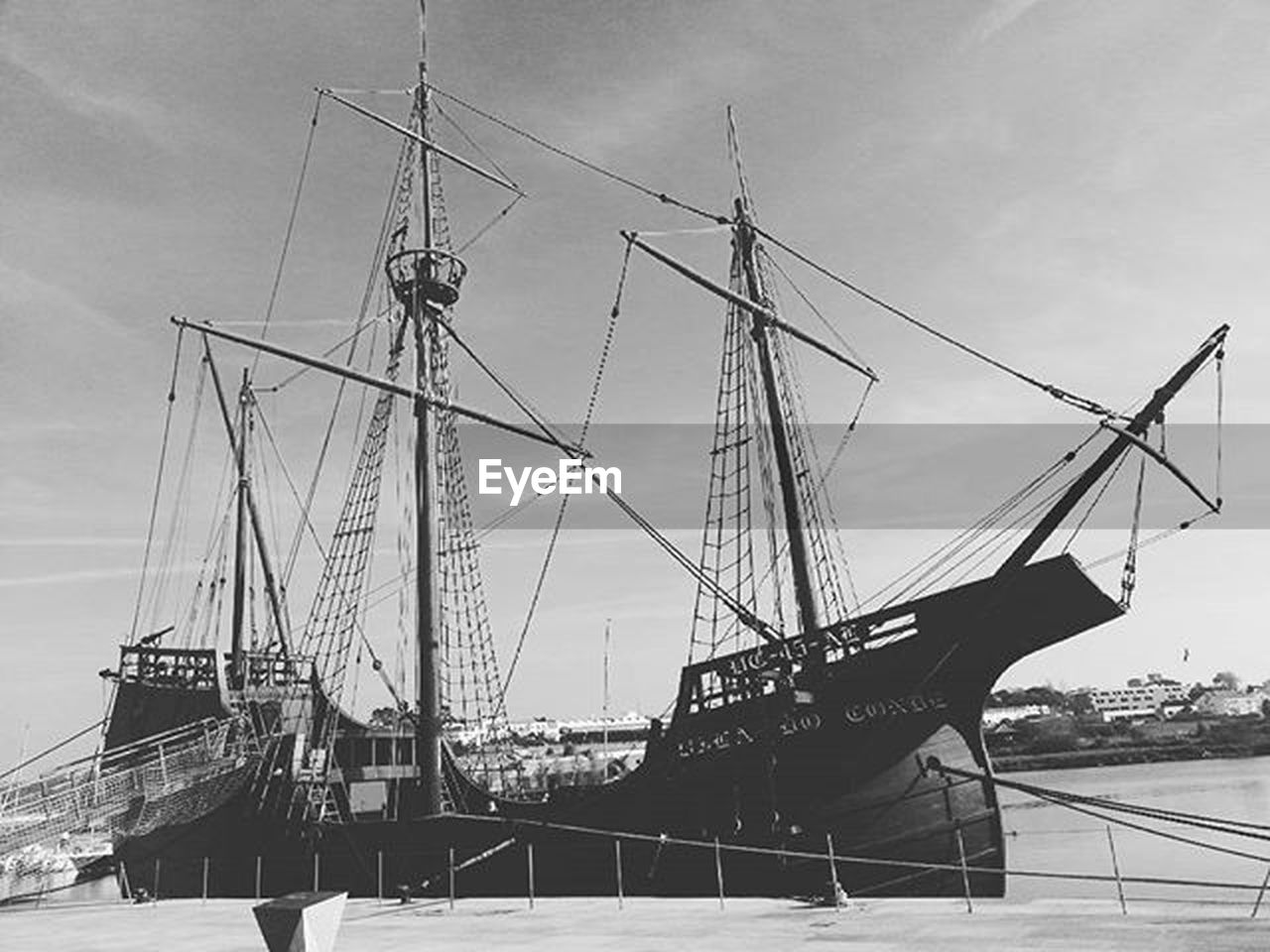 nautical vessel, transportation, harbor, tall ship, mode of transport, mast, ship, sailing ship, sea, sky, sailboat, outdoors, moored, no people, commercial dock, water, day, nature