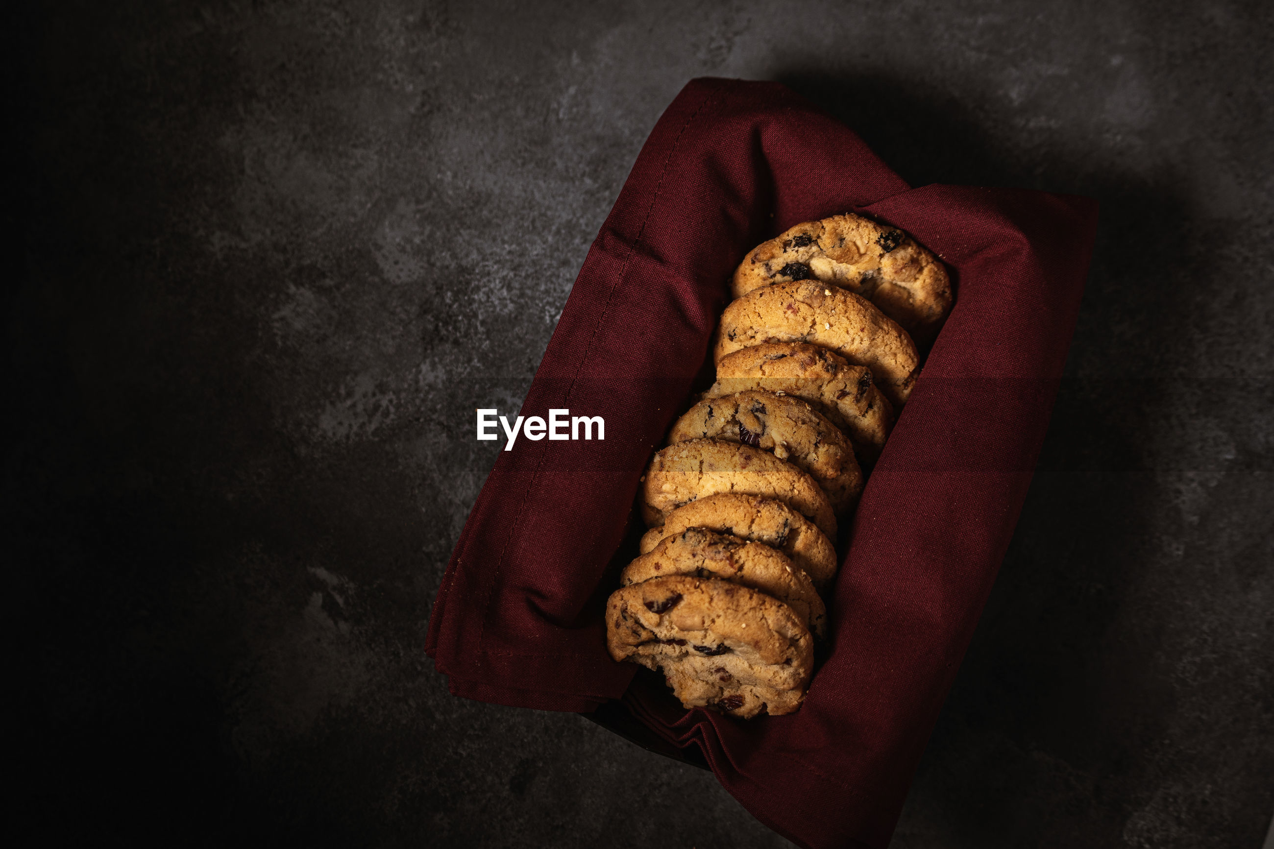 High angle view of cookies in tray against black background