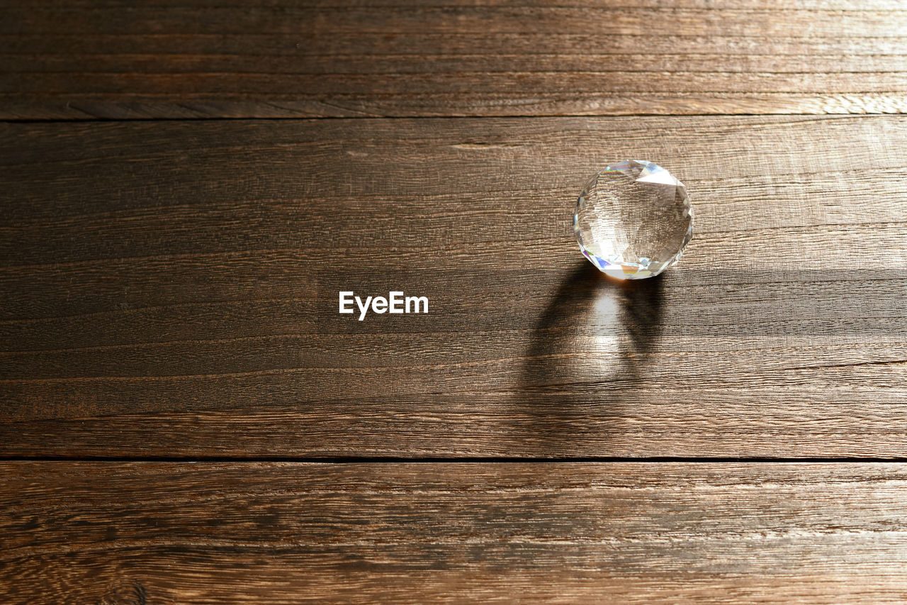 wood - material, table, indoors, high angle view, no people, directly above, single object, close-up, shadow, wood grain, still life, wood, copy space, nature, flooring, brown, sunlight, day, simplicity, textured