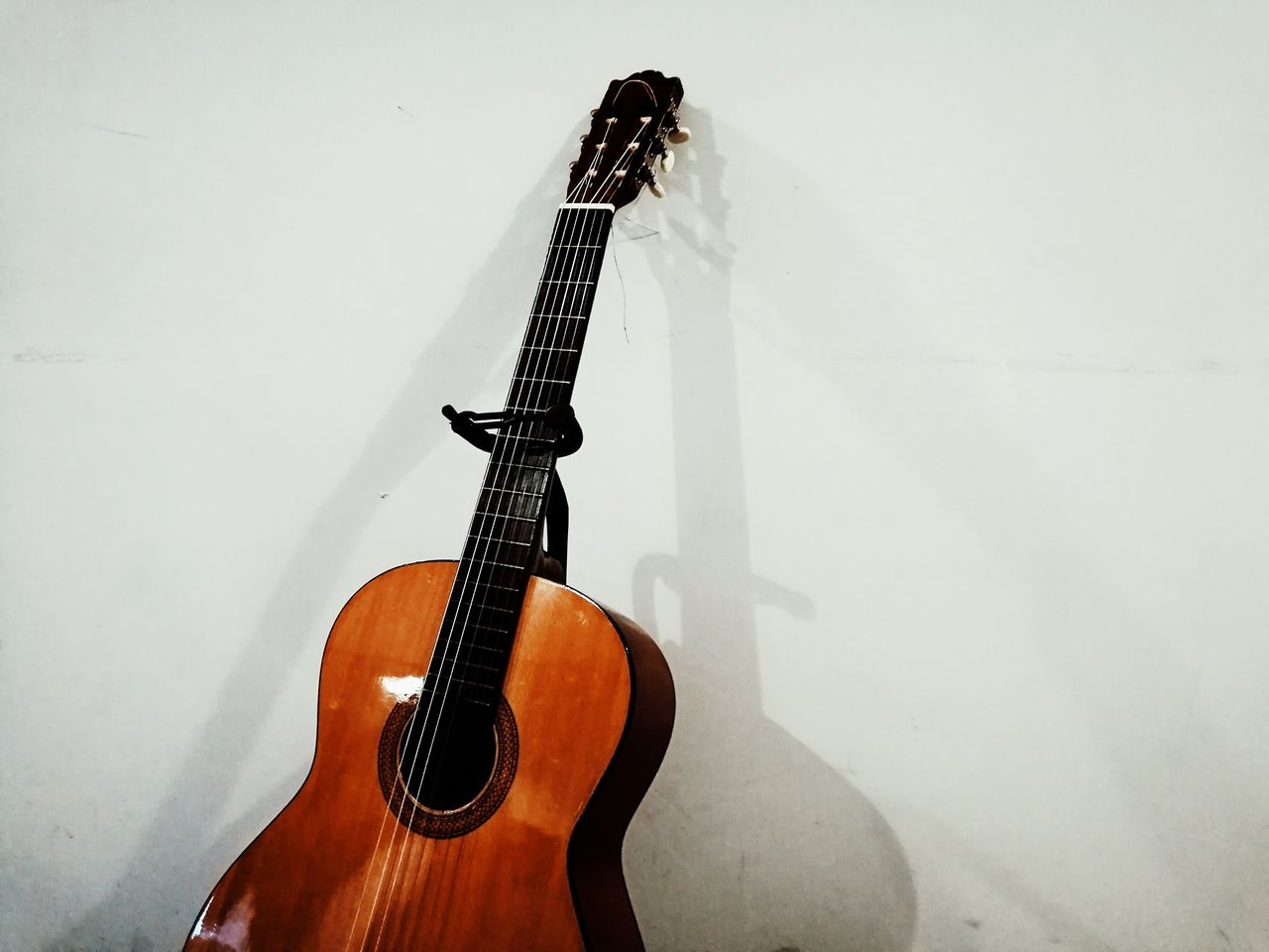 musical instrument, music, indoors, musical instrument string, no people, guitar, close-up, day
