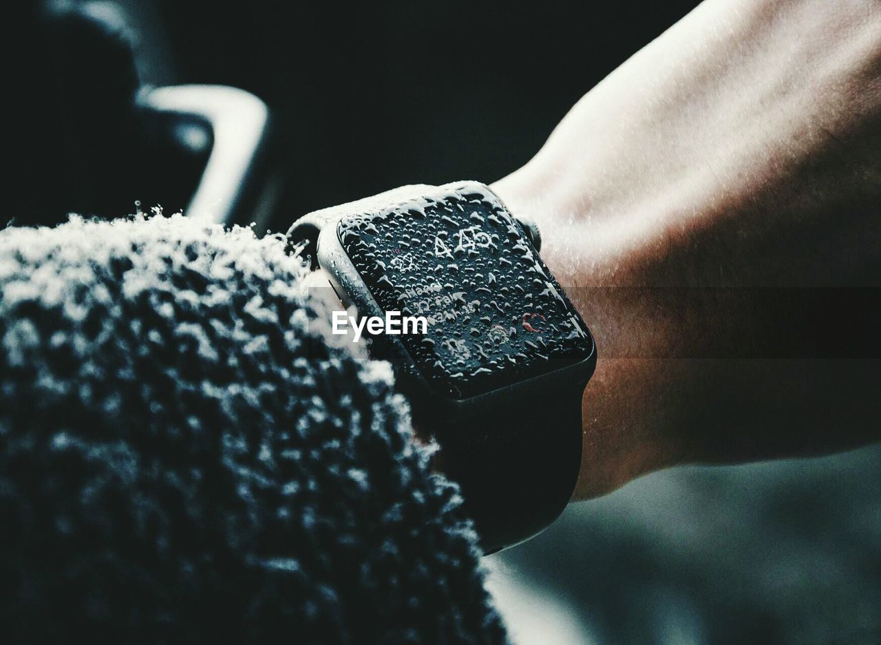 Close-up of water drops on wristwatch