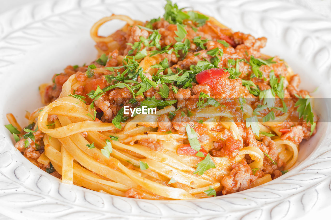 food, food and drink, ready-to-eat, freshness, pasta, italian food, serving size, plate, indoors, still life, healthy eating, close-up, vegetable, wellbeing, table, high angle view, indulgence, no people, garnish, focus on foreground, herb, spaghetti, temptation, crockery