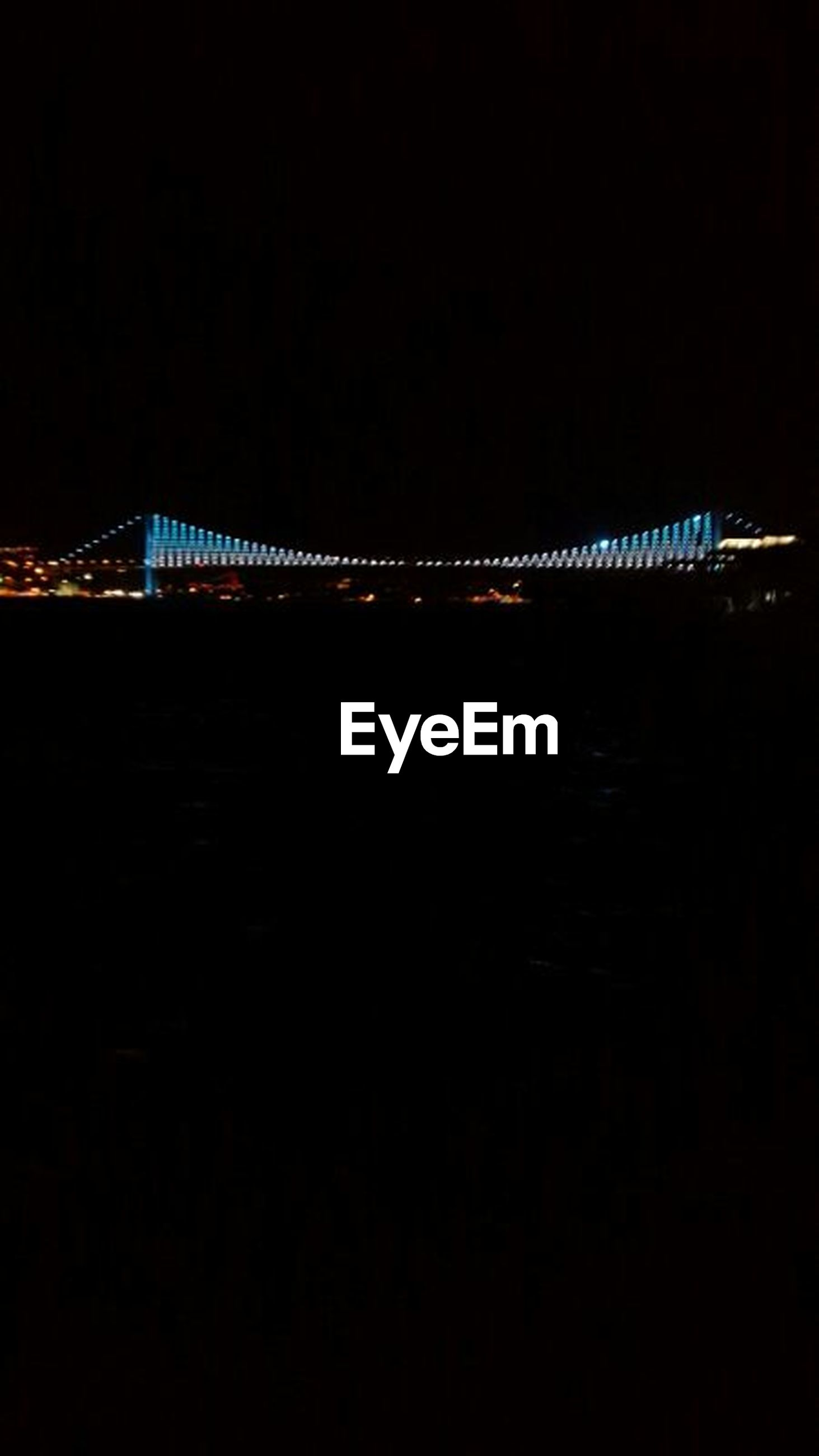 night, illuminated, bridge - man made structure, built structure, connection, architecture, copy space, dark, clear sky, engineering, bridge, city, suspension bridge, silhouette, low angle view, outdoors, sky, no people, transportation, building exterior