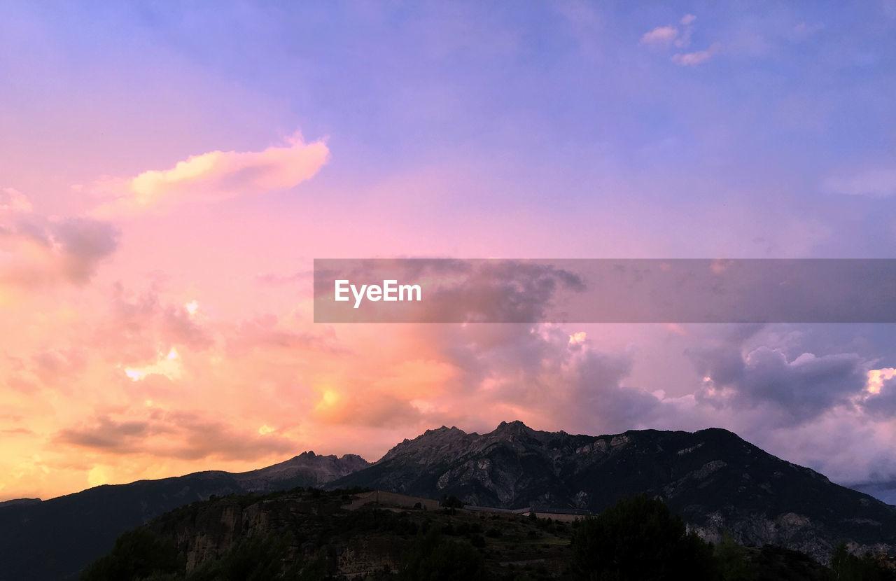 sky, mountain, cloud - sky, beauty in nature, sunset, tranquil scene, tranquility, scenics - nature, nature, mountain range, no people, environment, outdoors, idyllic, non-urban scene, orange color, landscape, mountain peak, dramatic sky, dusk