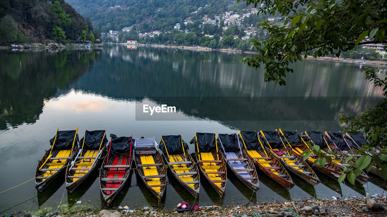 HIGH ANGLE VIEW OF BOATS MOORED AT RIVER