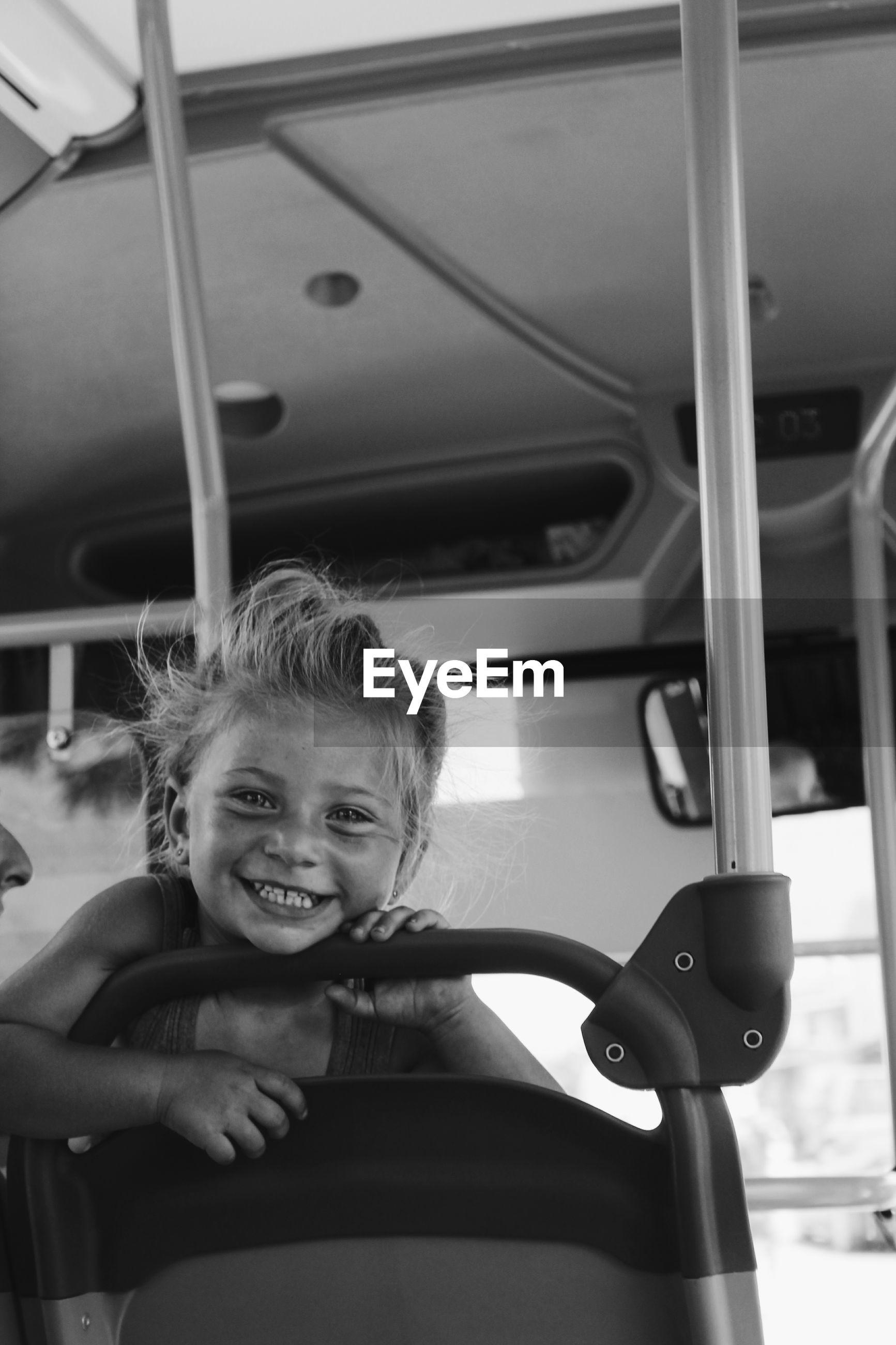 PORTRAIT OF HAPPY BOY IN CAR